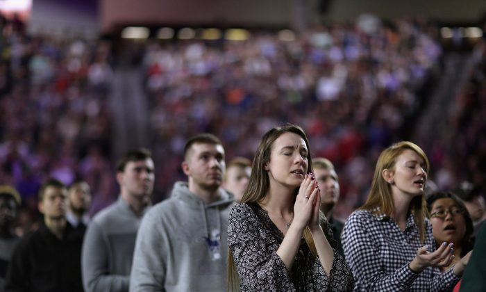 Thousands of students, supporters and invited guests sing songs of Christian praise before Republican presidential candidate Donald Trump delivers the convocation in the Vines Center on the campus of Liberty University  January 18, 2016 in Lynchburg, Virginia. Chip Somodevilla/Getty Images