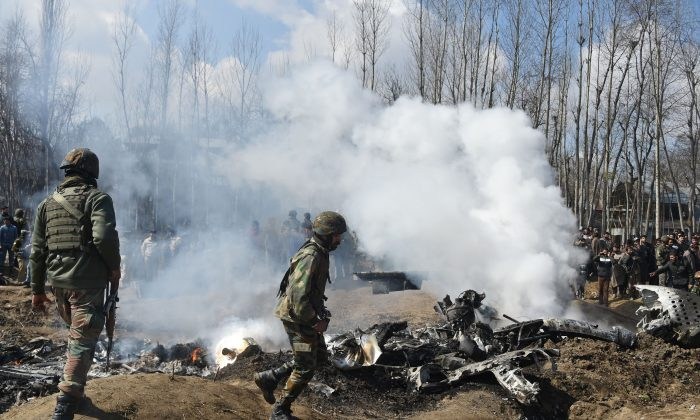 Indian soldiers inspect the remains of an Indian Air Force helicopter after it crashed in Budgam district, outside Srinagar on Feb. 27, 2019. (TAUSEEF MUSTAFA/AFP/Getty Images)
