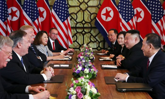 President Donald Trump and North Korea's leader Kim Jong Un, along with their respective entourages, attend an extended bilateral meeting in the Metropole hotel during the second North Korea-U.S. summit in Hanoi, Vietnam, on Feb. 28, 2019. (Leah Millis/Reuters)