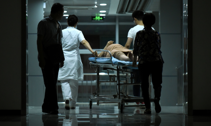 A pregnant woman on a stretcher in a hospital in Beijing, China. (Wang Zhao/AFP/Getty Images)