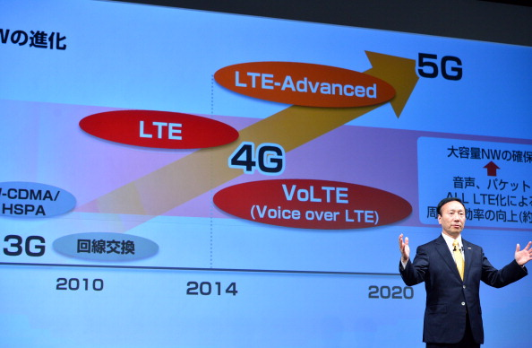Japan's mobile communication giant NTT Docomo former president Kaoru Kato announces the company will launch Japan's first service of voice-over LTE (VoLTE) at a press conference in Tokyo on May 14, 2014. (Yoshikazu Tsuno/AFP/Getty Images)