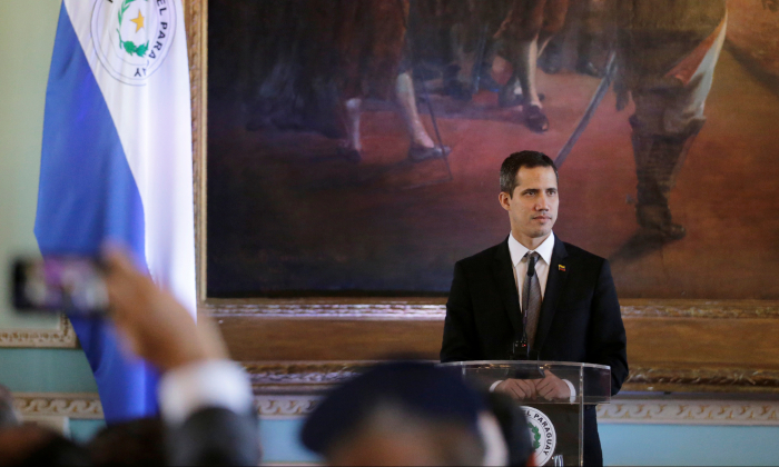 Venezuela's opposition leader Juan Guaido, who many nations have recognised as the country's rightful interim ruler looks on while attending a joint press conference with Paraguay's President Mario Abdo Benitez at the Lopez Palace in Asuncion, Paraguay, March 1, 2019.  (Jorge Adorno/Reuters)