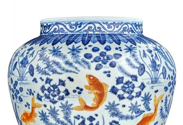 Chinese Underglazed Blue and Iron Red Porcelain Fish Jar. This potted jar is painted in the round with eight iron-red carp swimming amid lotus blossoms and water weeds. Qing Dynasty, Height 12 3/8 inches. This jar is being auctioned by Doyle New York on March 18 for an estimated $20,000 to $30,000. (Courtesy of Doyle New York)