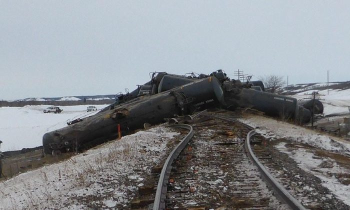 Derailed rail cars near St-Lazare, Manitoba are shown in a handout photo from the Transportation Safety Board. (The Canadian Press/HO-Transportation Safety Board)
