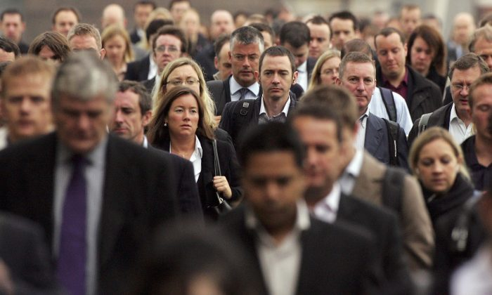 Commuters walk to work over London Bridge in London on Oct. 5, 2006.  Scott Barbour/Getty Images