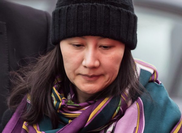 Huawei chief financial officer Meng Wanzhou arrives at a parole office, in Vancouver, on Dec. 12, 2018. Canada announced on Mar. 1 that the extradition hearing against Meng would proceed. (The Canadian Press/Darryl Dyck)