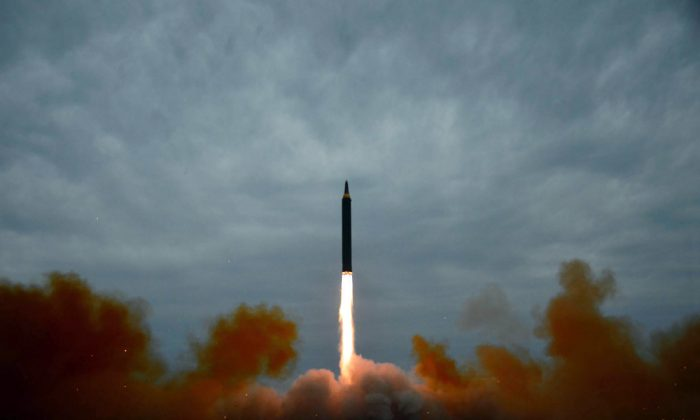 This picture from North Korea's official Korean Central News Agency (KCNA) taken on Aug. 29, 2017 and released on August 30, 2017 shows North Korea's intermediate-range strategic ballistic rocket Hwasong-12 lifting off from the launching pad at an undisclosed location near Pyongyang. (STR/AFP/Getty Images)