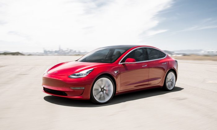 Red Static Rear Model 3 of Tesla. (Press Kit/Tesla Inc.)