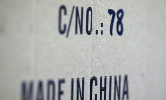 Words 'Made in China' are pictured on a box of products imported from China at a wholesale shop in Paris, France. (Regis Duvignau/Reuters)