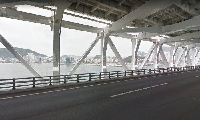 Officials told the Yonhap News Agency that the 6,000-ton Seagrand vessel hit the side of the Gwangan Bridge in Busan, pictured above. (Google Street View)