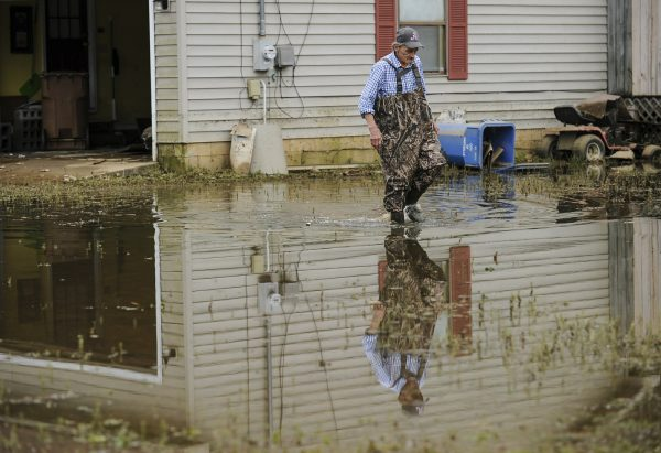 Kenny Thomas walks outside his home in Hartselle