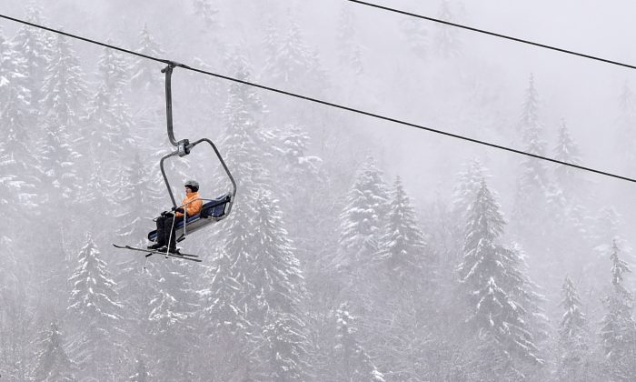 In this file image, a skier rides a ski lift in the popular Ukrainian ski resort of Bukovel, in the Carpathian Mountains, on Dec. 15, 2017. (Sergei Supinsky/AFP/Getty Images)