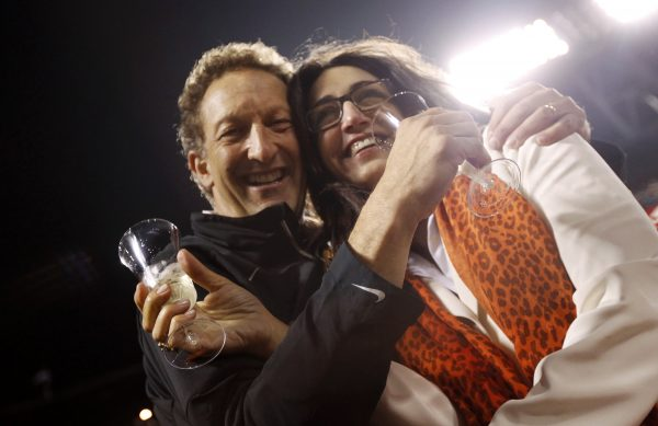 Giants President Baer and wife Pam celebrate after Giants defeated Padres in MLB game in San Francisco