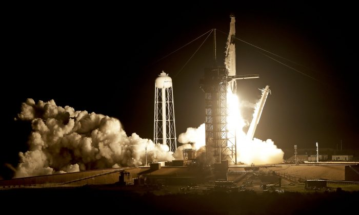 A SpaceX Falcon 9 rocket with a demo Crew Dragon spacecraft on an uncrewed test flight to the International Space Station lifts off from pad 39A at the Kennedy Space Center in Cape Canaveral, Fla., on March 2, 2019. (John Raoux/AP)