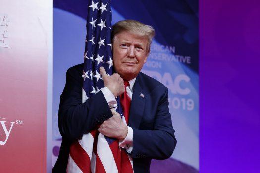 Donald Trump hugs flag at CPAC 2019