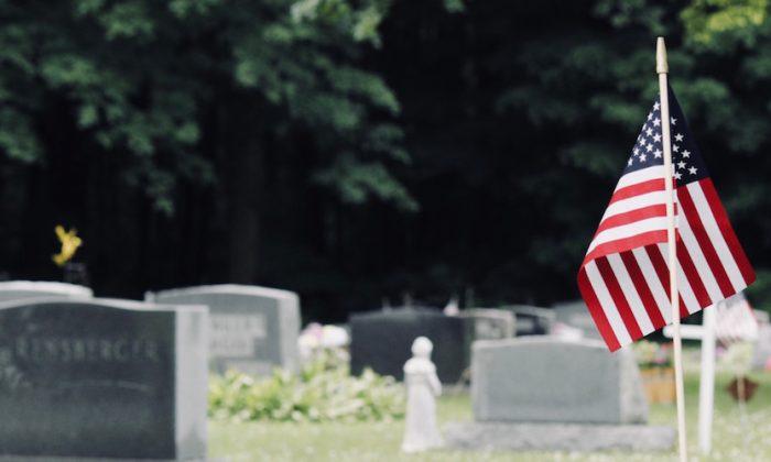 An American flag at a cemetery. (Sydney Rae/Unsplash)