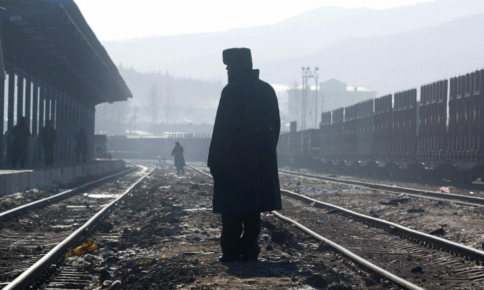 A Chinese paramilitary officer between railroad tracks. (FREDERIC J. BROWN/AFP/Getty Images)