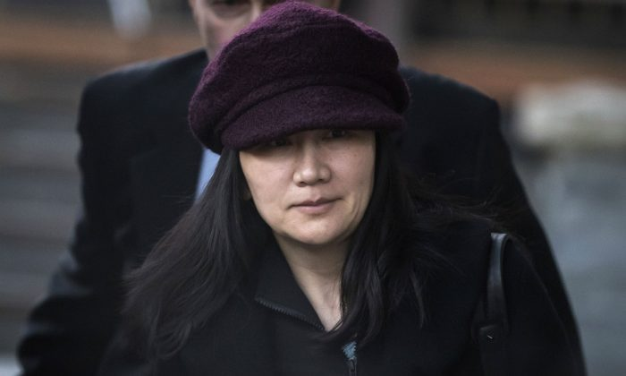 In this Jan. 29, 2019, file photo, Huawei chief financial officer Meng Wanzhou leaves her home to attend a court appearance in Vancouver, British Columbia. (Darryl Dyck/The Canadian Press via AP, File)