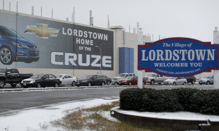 A banner depicting the Chevrolet Cruze model vehicle is displayed at the General Motors' Lordstown plant, in Lordstown, Ohio. On Nov. 27, 2018. (AP Photo/John Minchillo)