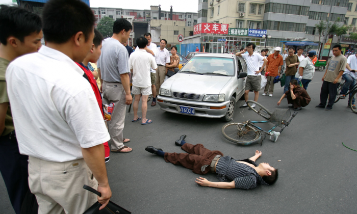 A man in a traffic accident in Beijing, China. (Cancan Chu/Getty Images)