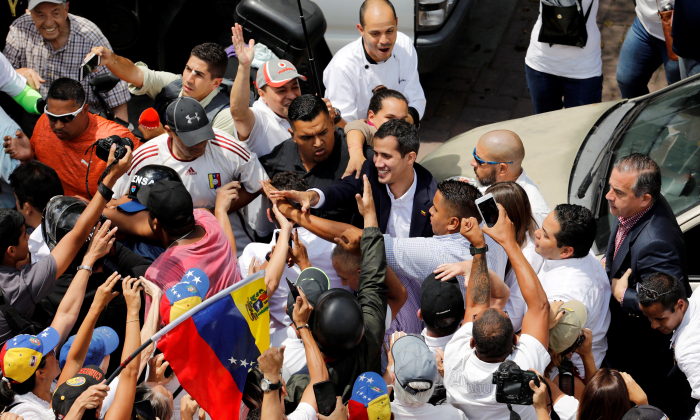 Venezuelan interim President Juan Guaido greets supporters during a rally against illegitimate socialist dictator Nicolas Maduro's government in Caracas on March 4, 2019. (Manaure Quintero/Reuters)