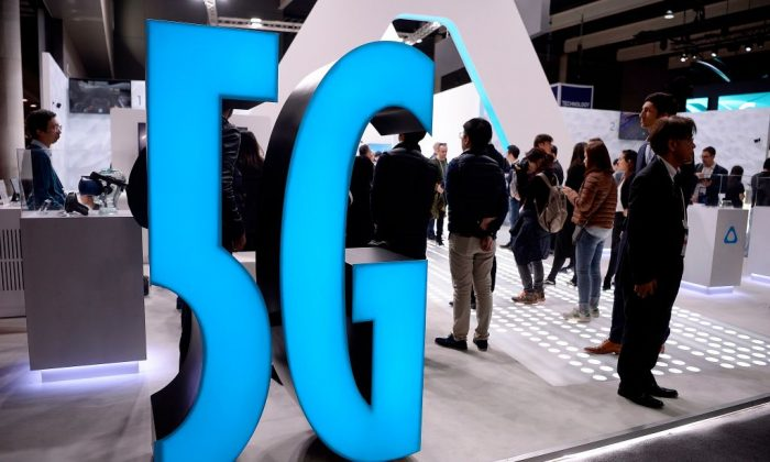 A 5G sign is displayed at a stand at the Mobile World Congress (MWC) in Barcelona on Feb. 25, 2019. (Josep Lago/AFP/Getty Images)