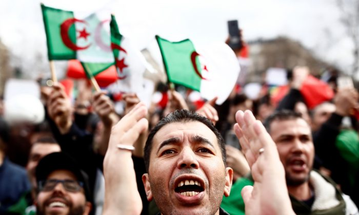 Demonstrators gather near the Monument to the Republic during a protest against Algerian President Abdelaziz Bouteflika seeking a fifth term in a presidential election set  in Paris, France, on Mar. 3, 2019. (Christian Hartmann/Reuters)