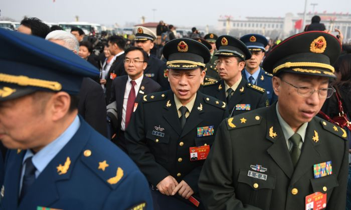 Military delegates arrive to attend the opening session of the Chinese People's Political Consultative Conference (CPPCC) at the Great Hall of the People in Beijing on March 3, 2019. (GREG BAKER/AFP/Getty Images)