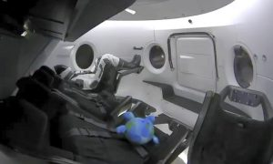 US-Built Capsule With a Dummy Aboard Docks at Space Station