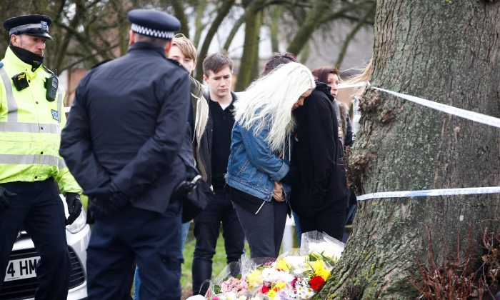 People visit  a site near to where 17-year-old Jodie Chesney was killed, at the Saint Neots Play Park in Harold Hill, east London, Britain March 3,  2019. REUTERS/Henry Nicholls