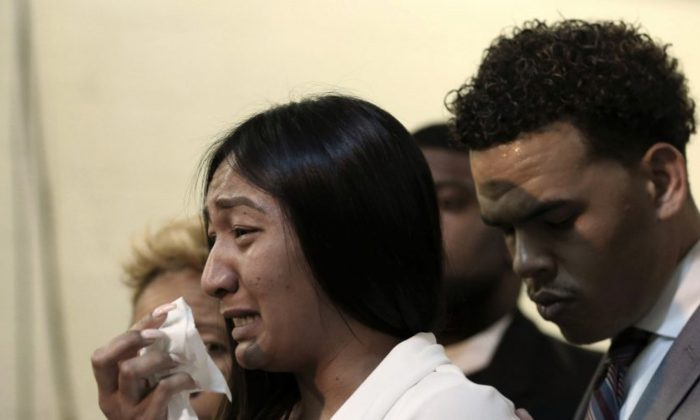Salena Manni, the fiancee of Stephon Clark, who was shot and killed by Sacramento police in 2018, cries as she discusses the decision to not file charges against the two officers involved, during a news conference in Sacramento, Calif., on Mar. 2, 2019. (AP Photo/Rich Pedroncelli)