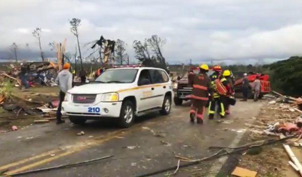 Emergency responders work in the scene amid debris in Lee County