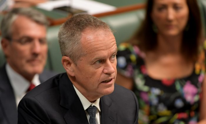 Opposition leader Bill Shorten responds to Prime Minister Scott Morrison after he announced to the parliament that the Liberal party, Nationals party and the Labor party were all recently hacked at Parliament House in Canberra, Australia on Feb. 18, 2019. (Tracey Nearmy/Getty Images)