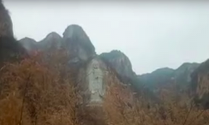 The tallest standing Guanyin statue carved in a cliff in Hebei Province, China. The Chinese regime destroyed the statue on Feb. 2, 2019. (Screenshot via Bitter Winter Youtube video)