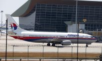 Malaysian Prime Minister Tells MH370 Family Member 'We Intend to Continue' Search