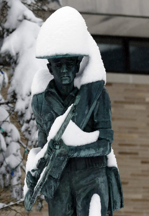 Snow covers the Spanish-American War Memorial after an overnight snowstorm