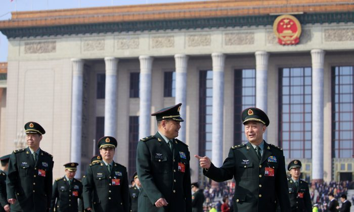 Military delegates leave the Great Hall of the People after a meeting ahead of National People's Congress (NPC), China's annual meeting of the Chinese Communist Party's political advisory body, at the Great Hall of the People in Beijing on March 4, 2019. (Aly Song/Reuters)