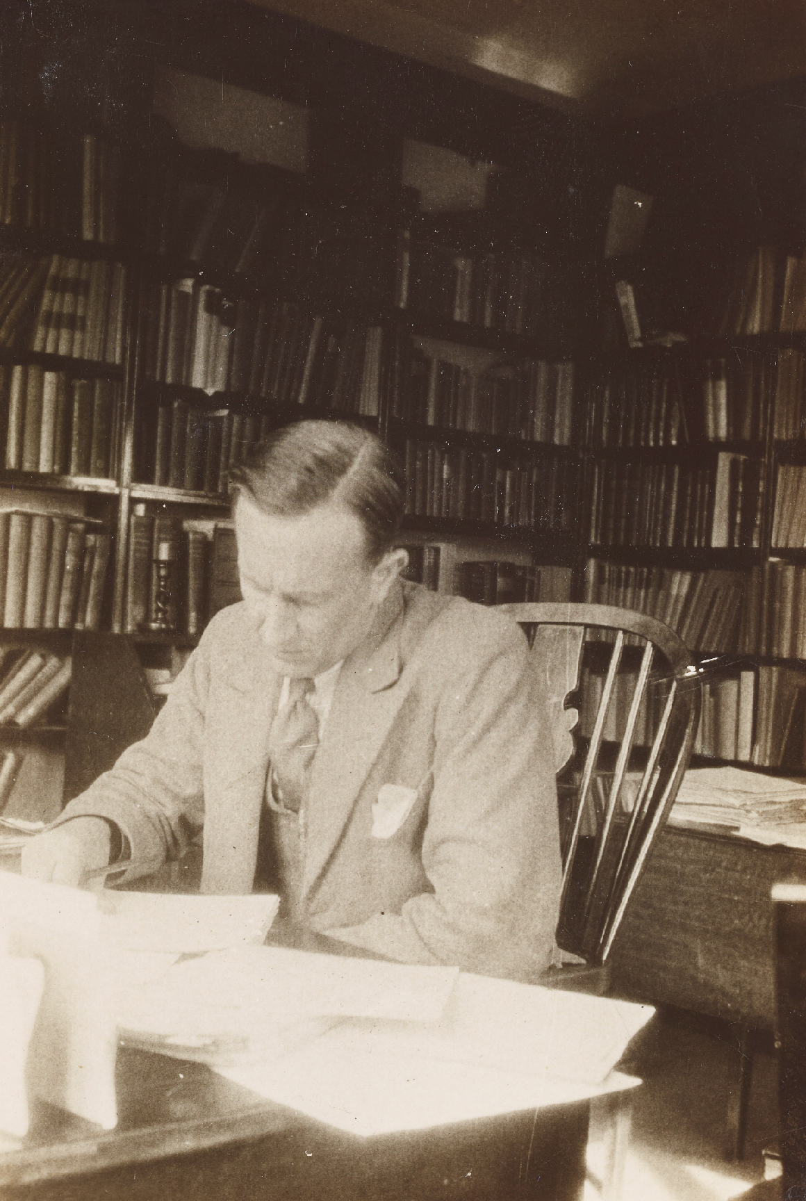 Man writing in his study