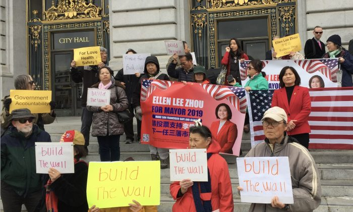 Ellen Zhou and supporters on the steps in front of San Francisco City Hall on February 25, 2019. (Cynthia Cai/Epoch Times)