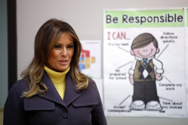 First lady Melania Trump enters a classroom to visit with students