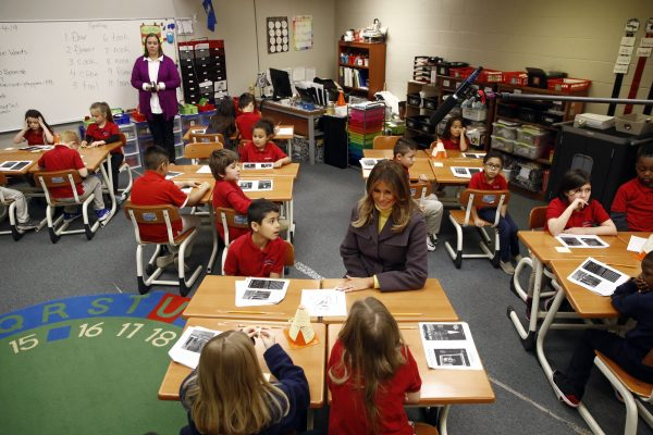 First lady Melania Trump visits with students in a classroom