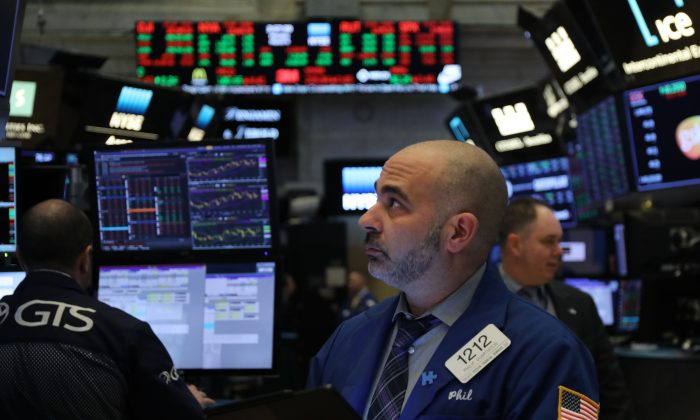 Traders work on the floor of the New York Stock Exchange (NYSE)  in New York City, on March 4, 2019. (Spencer Platt/Getty Images