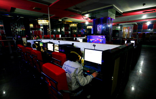 Customers use computers at an internet cafe in Hami, a city in northwestern China's Xinjiang region on Jan. 16, 2011. (STR/AFP/Getty Images)