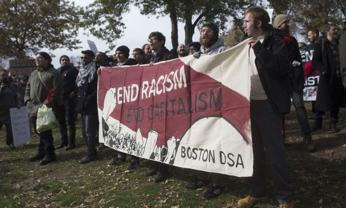 Counter-protesters of an event organized by conservative groups Resist Marxism and Boston Free Speech chant and hold up signs in Boston, on Nov. 18, 2017. (Scott Eisen/Getty Images)