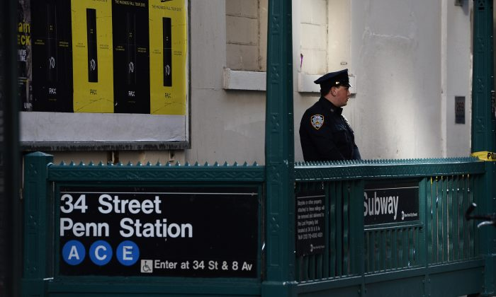 FILE—A New York Police Department (NYPD) officer securing the entrance of the 34 St. Penn Station subway station following a shooting incident in New York City on Nov. 9, 2015. (Jewel Samad/AFP/Getty Images)