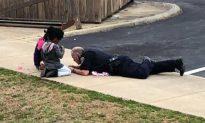 Cop Plays Games with Frightened Children on Sidewalk After False Gas Leak Alarm