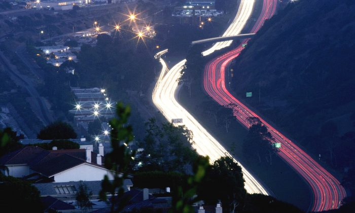 Traffic moves along the I-5 in San Diego, California on August 31, 2006.  (Photo by Sandy Huffaker/Getty Images)