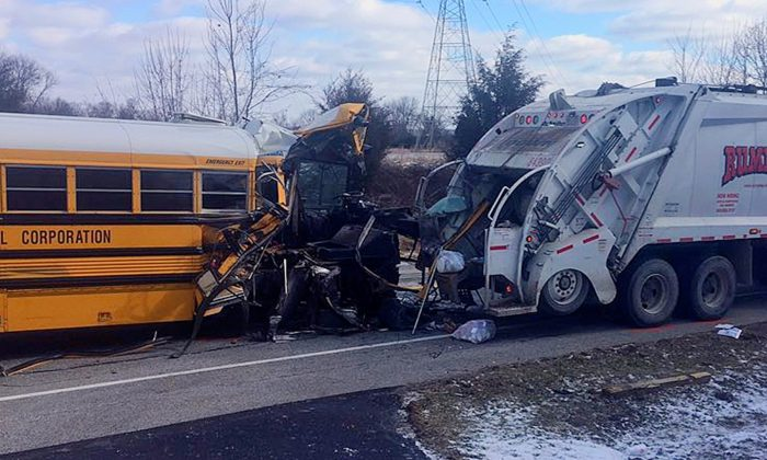 A school bus collided with a garbage truck near Aurora, Ind., on March 6, 2019. (Sgt. Stephen Wheeles/Indiana State Police via AP)