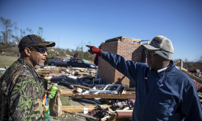 Dexter Norwood, left, and Bernard Reese talk about the people they found in the rubble immediately following a tornado that devastated their neighborhood in Beauregard, Ala., Tuesday, March 5, 2019. Both men said they were haunted by the memories of seeing bodies they helped find. (AP Photo/David Goldman)