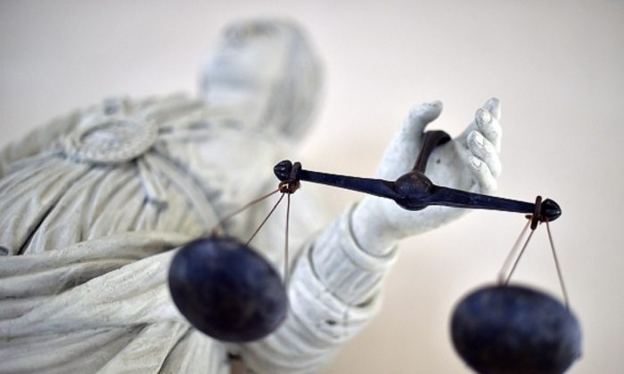 A statue of the goddess of Justice balancing the scales at Rennes' courthouse on Sept. 19, 2017. (Loic Venance/AFP/Getty Images)
